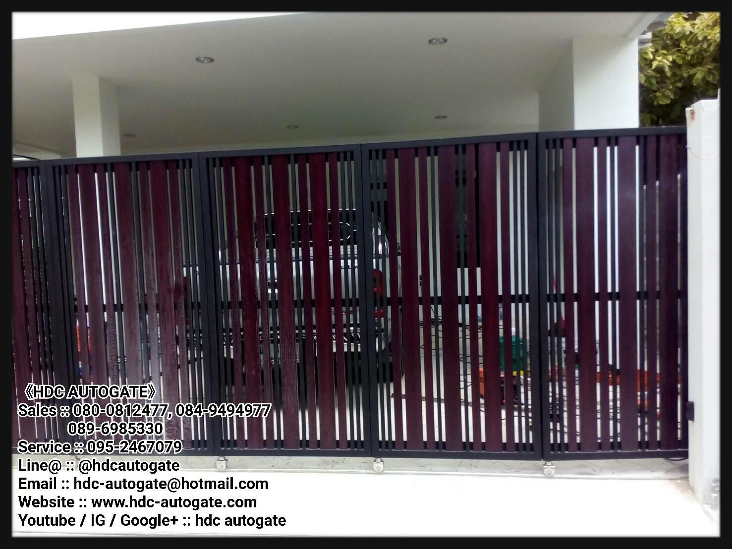 ผลงานออกแบบ ผลิตและติดตั้งประตูรั้วเหล็กติดอลูมิเนียมลายไม้บานโค้ง บานซ้อนสาม พร้อมติดมอเตอร์ประตูรีโมทบานเลื่อนสำหรับทุกรูปแบบ ด้วยมอเตอร์ Roger SLR 800kg. Made in Italy  ที่ซอยอารียสัมพันธ์